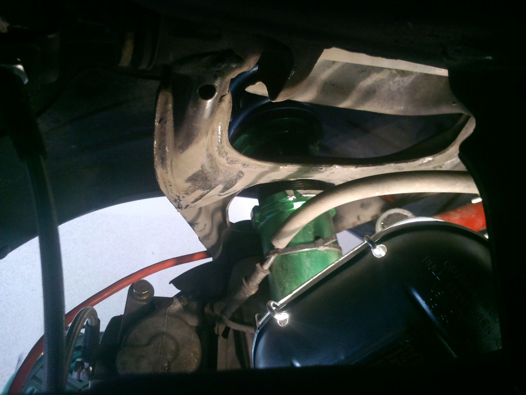 coilover rubbing the control arm opening